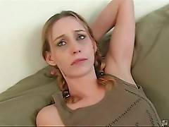 Naughty blonde spreads legs and starts rubbing her pussy.