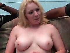 Cute blonde Jordan James is readily stripping for two black dudes.